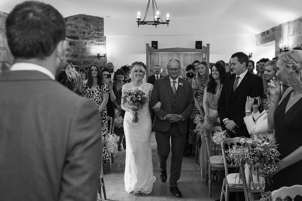 The bride as she walks down the aisle