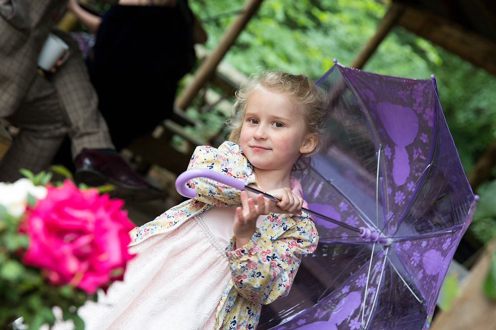 Cute wedding photography: little girl holding umbrella