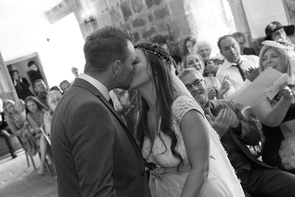 The couple kissing by North Yorkshire wedding photographer