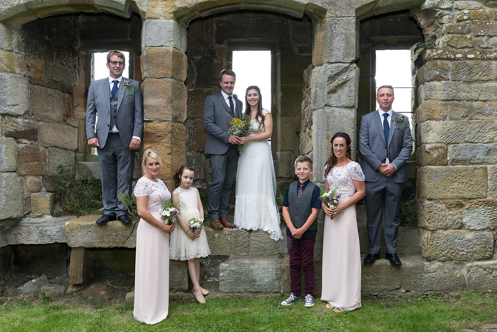 Wedding photo of the bridal party in castle ruins