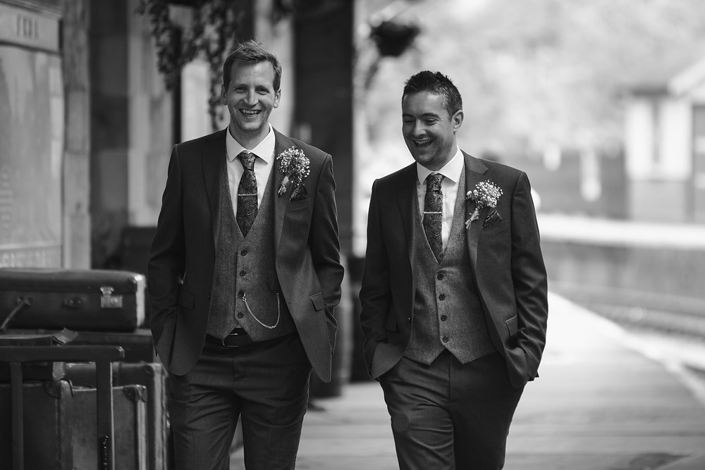 The Groom & the best man laughing