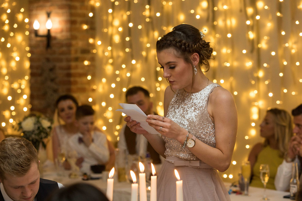 Candid wedding photograph of the Bridesmaid giving a speech
