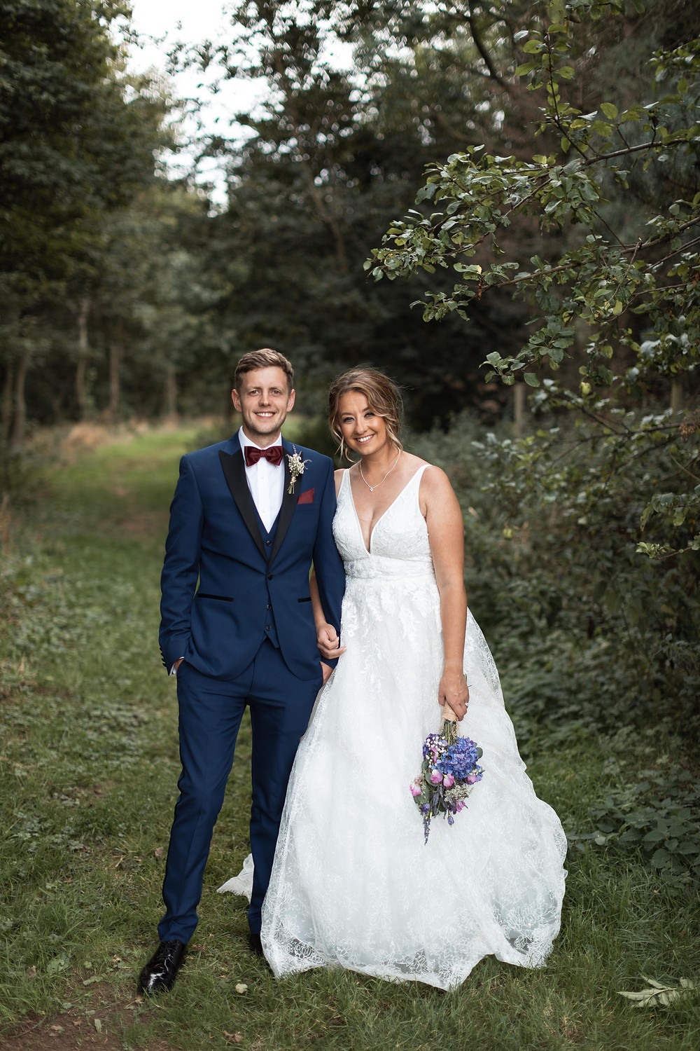Full length wedding portrait of the bride and groom