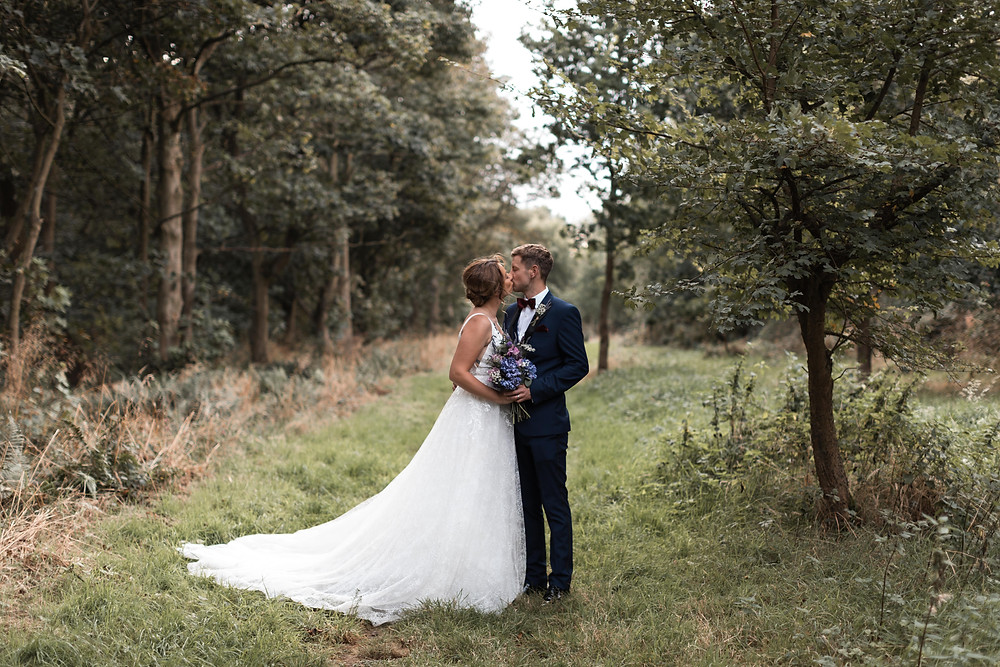 Portrait of the bride and groom in a woodland location