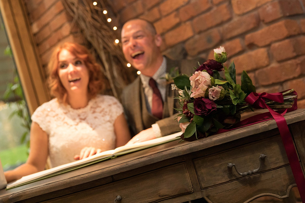 Natural wedding photography: the bride & groom laughing