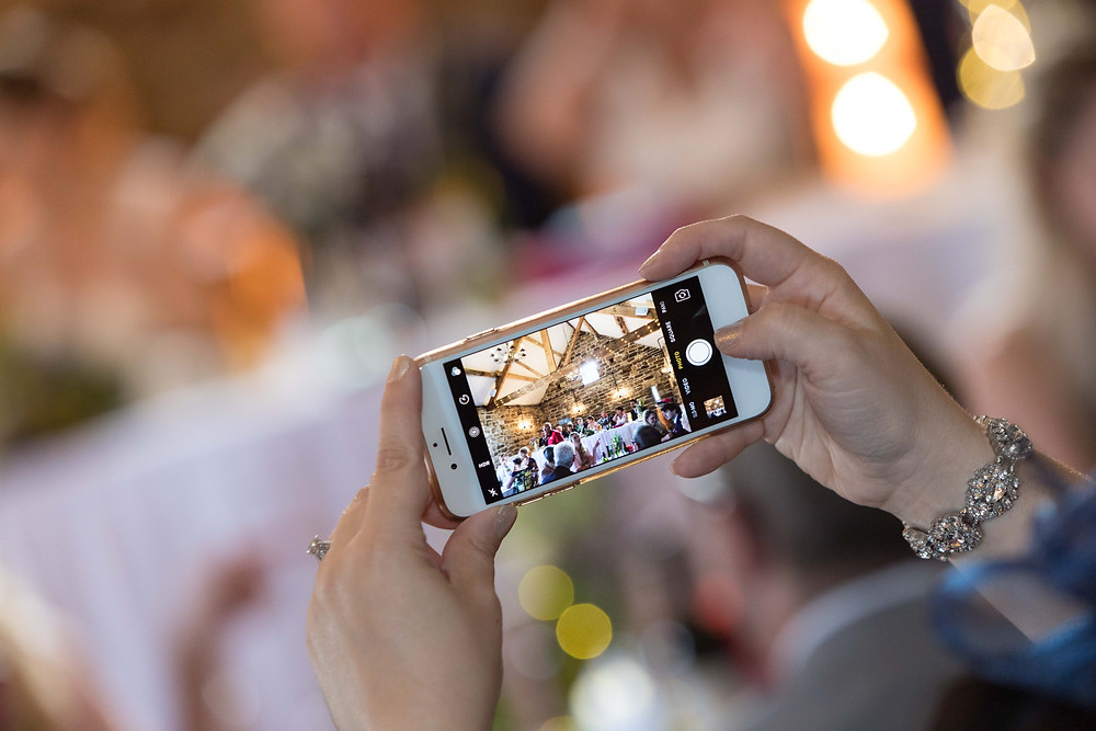 image of a guest taking a photo with their phone