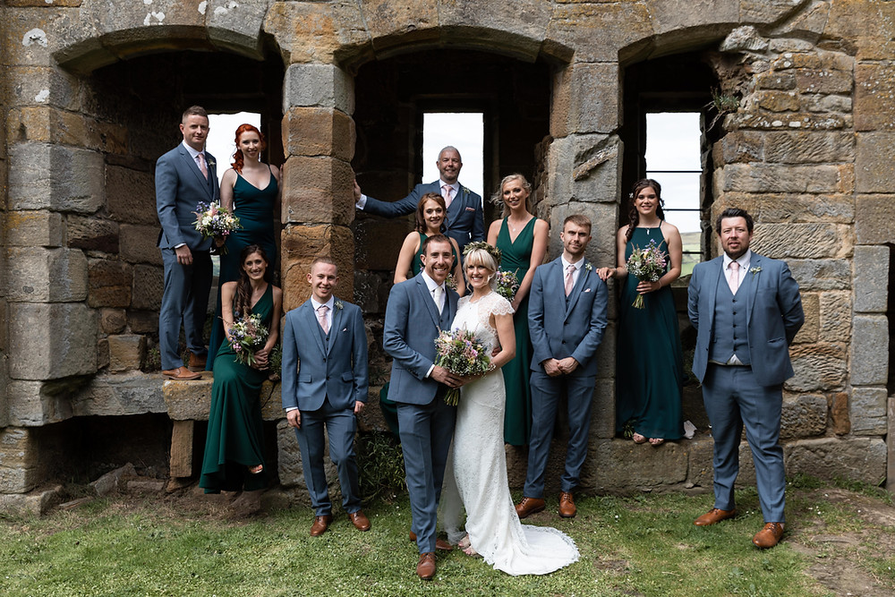 Wedding group portrait in the castle ruins
