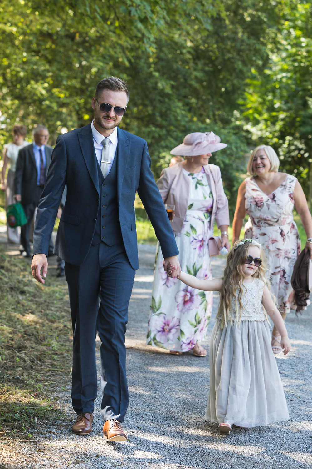 The Groom and the flower girl walking
