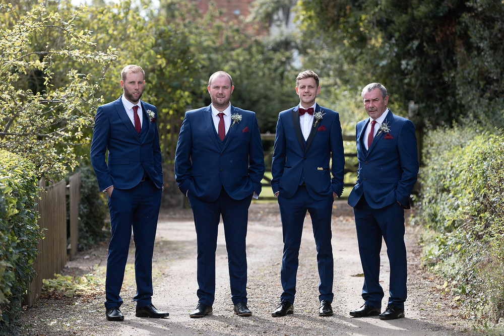 Portrait of the groom and his groomsmen