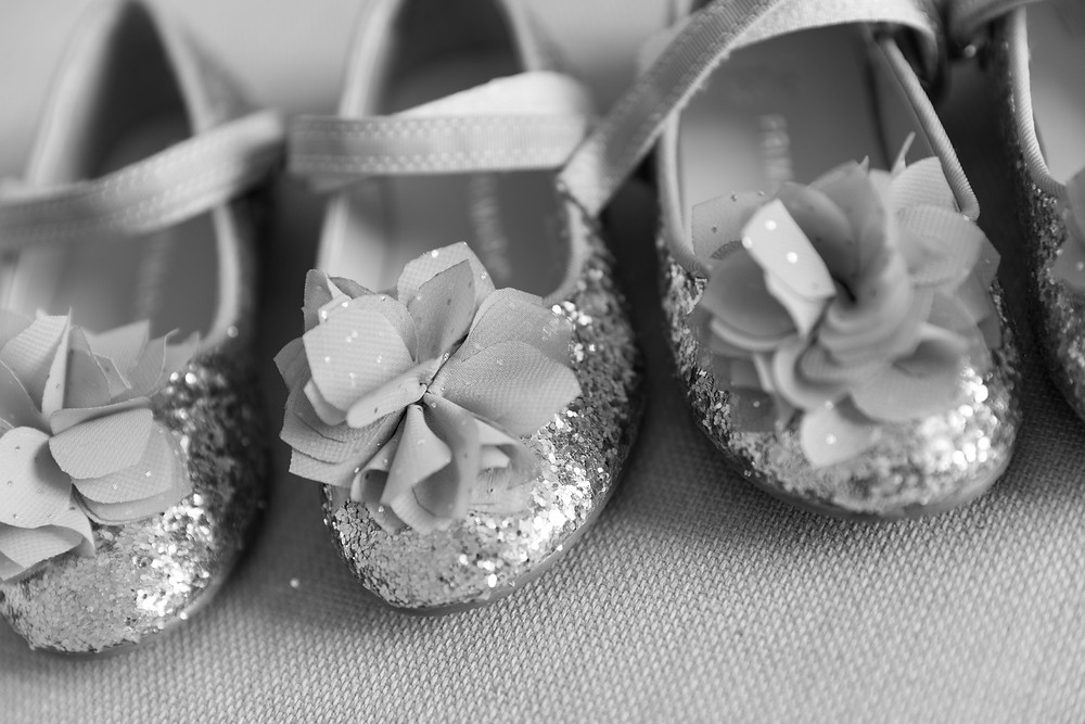Close-up detail shot of the flower girls shoe's