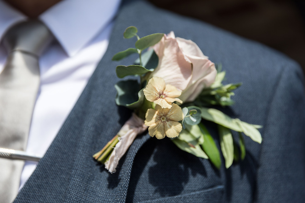 Close up of the grooms button hole