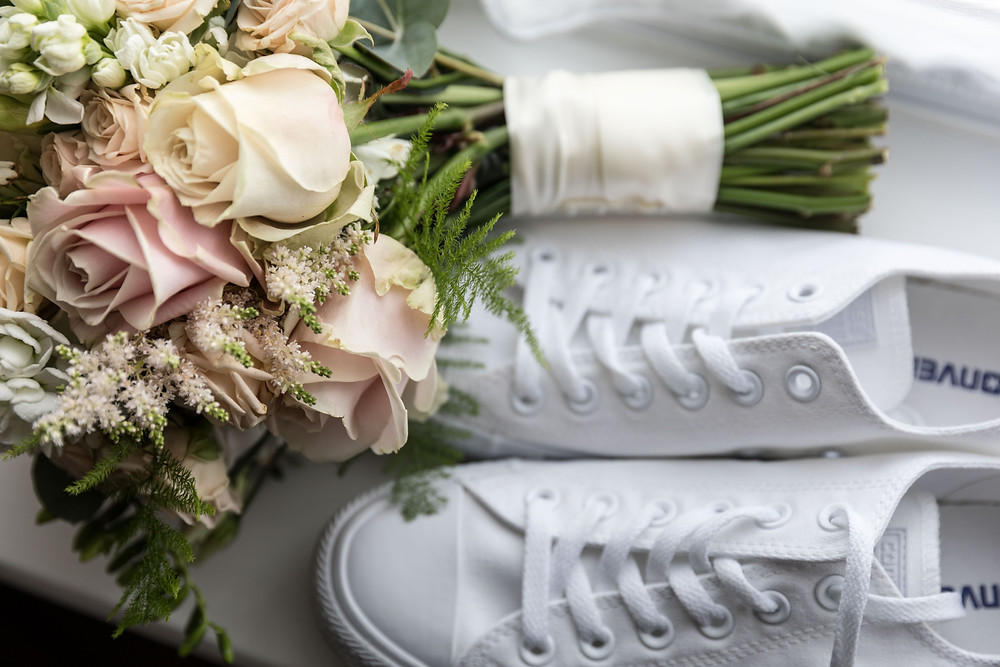 Brides shoes & bouquet by Whitby Wedding Photographer