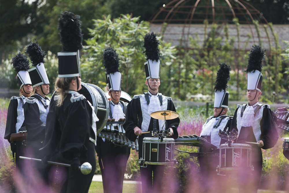 Wedding guests enjoy the marching band
