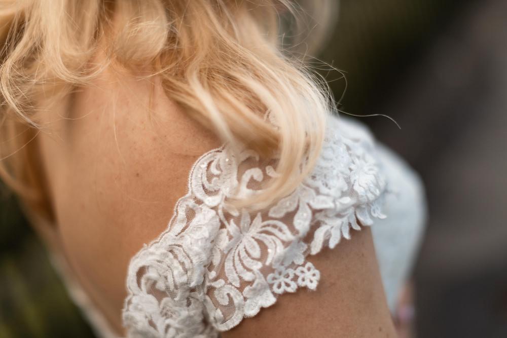 Detail shot of the brides dress