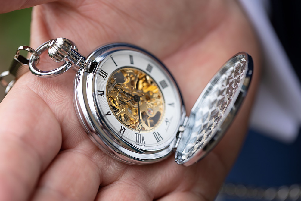 a detail shot of the Groom's pocket watch
