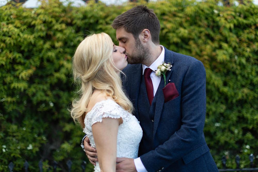 Wedding photo: the bride & groom kissing