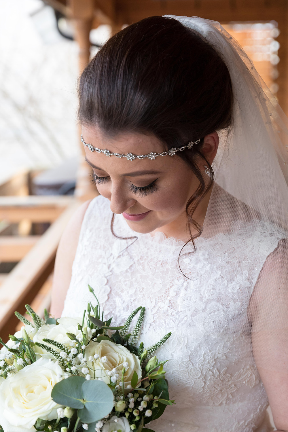 portrait of the bride with her flowers by Jack Cook Photography