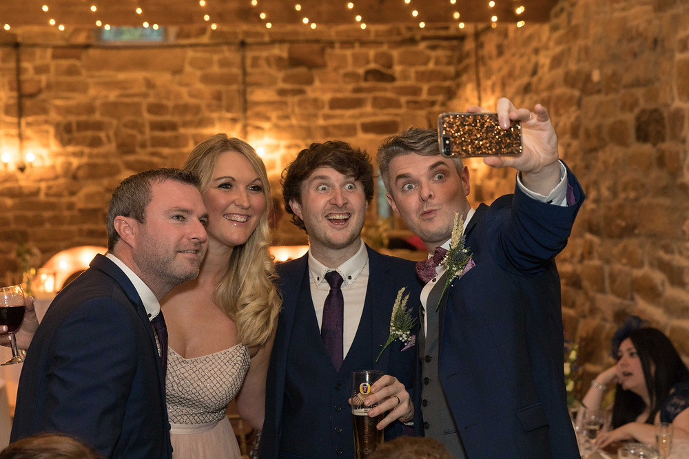 wedding photograph of guests taking a selfie