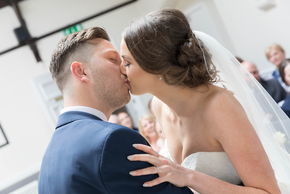 Wedding photographer captures first kiss