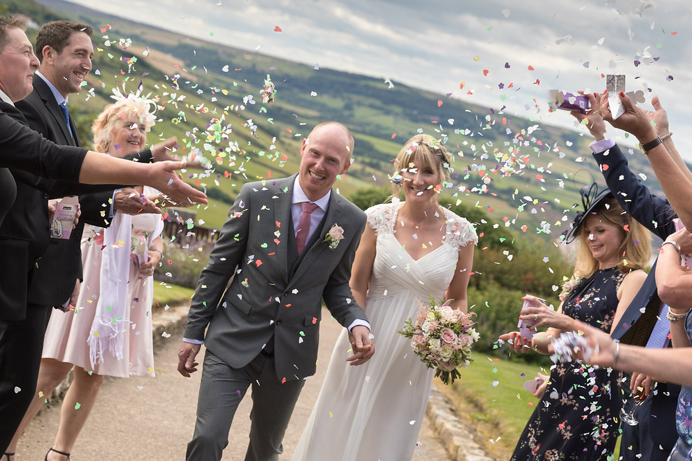 Stunning wedding photography: the bride & groom in confetti
