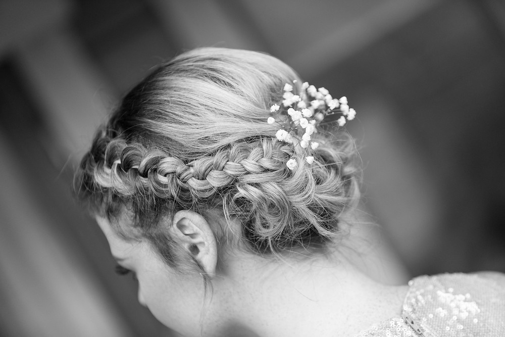 black & white shot of the bridesmaids hair