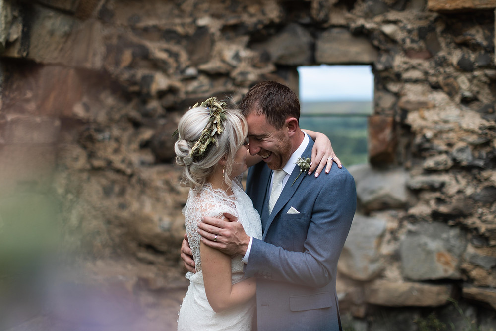The bride and groom in the castle ruins