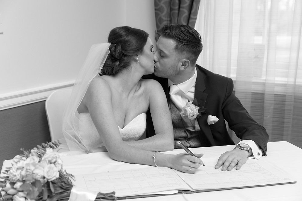Signing the register by Whitby wedding photographer