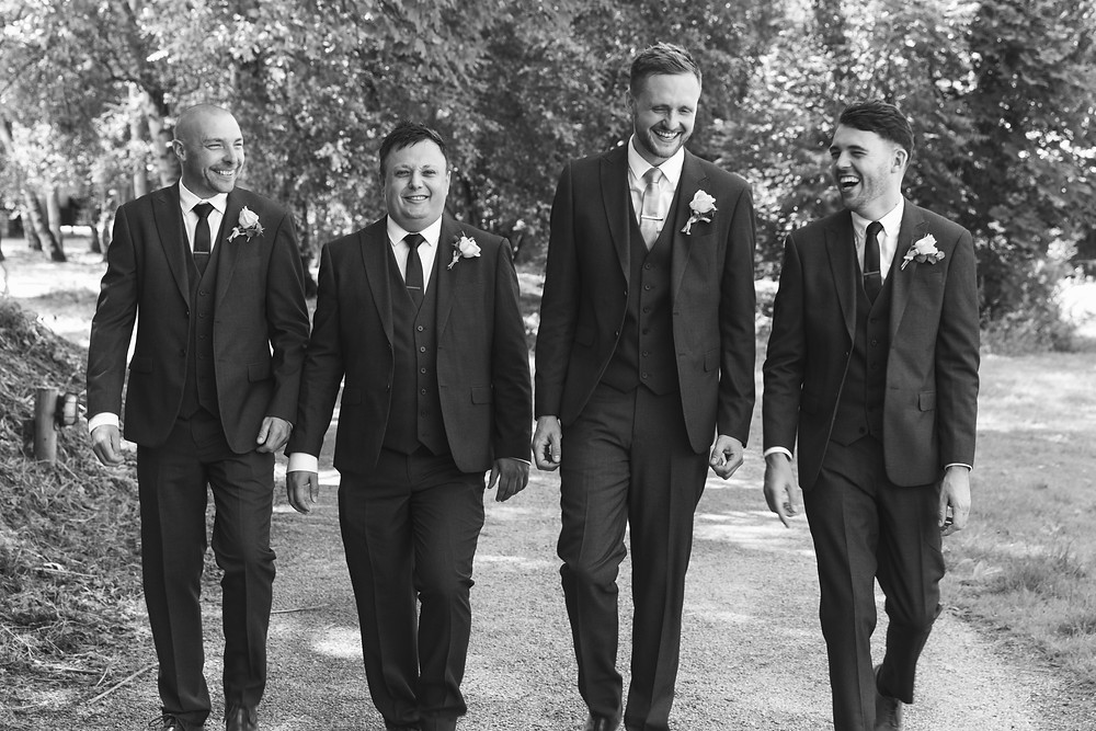 Natural wedding photograph of the Groom & his groomsmen