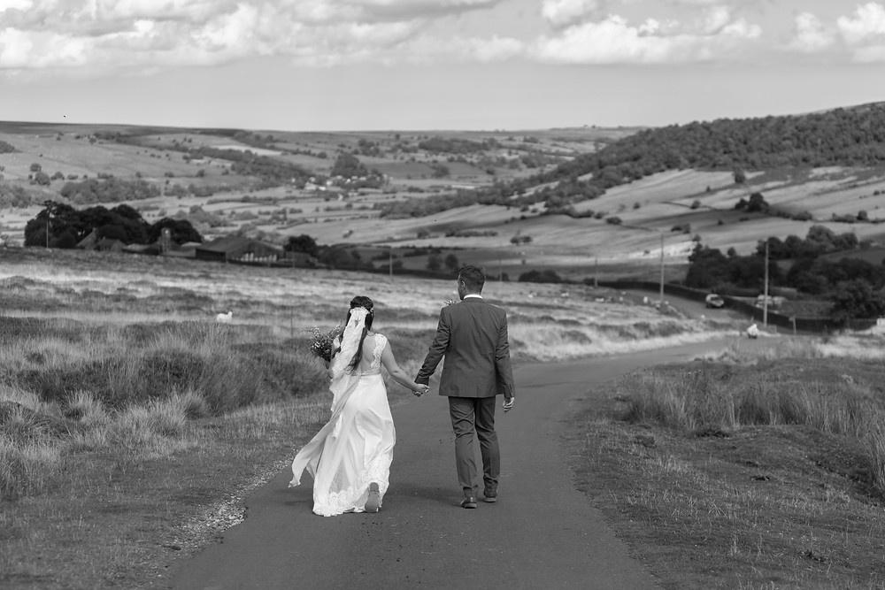 Black & white wedding photograph of the bride & Groom