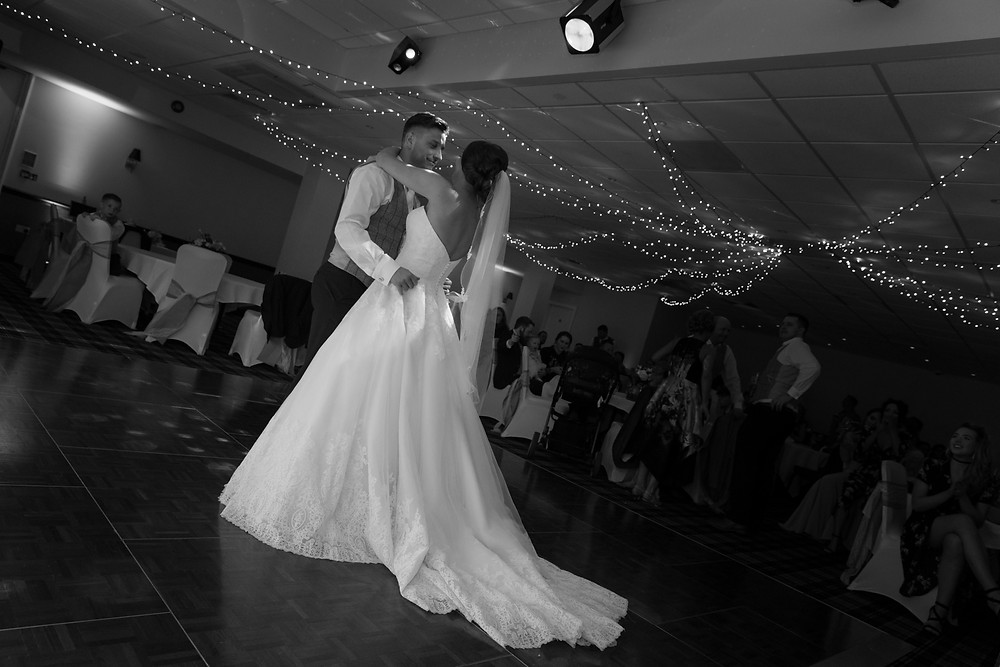 Black & white wedding photo of the first dance