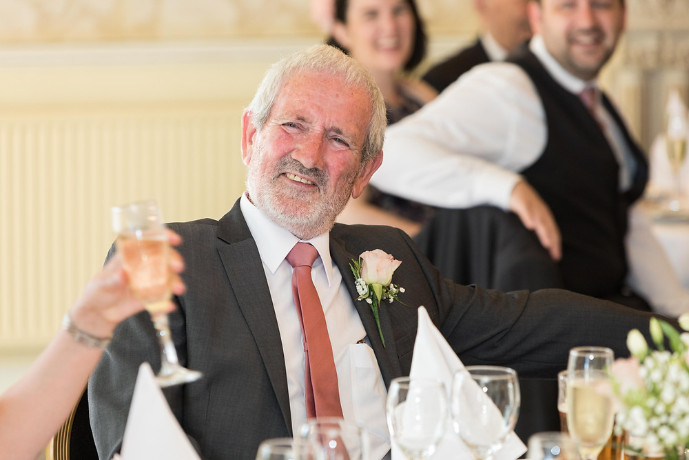 Wedding guest laughing captured by Jack Cook photographer