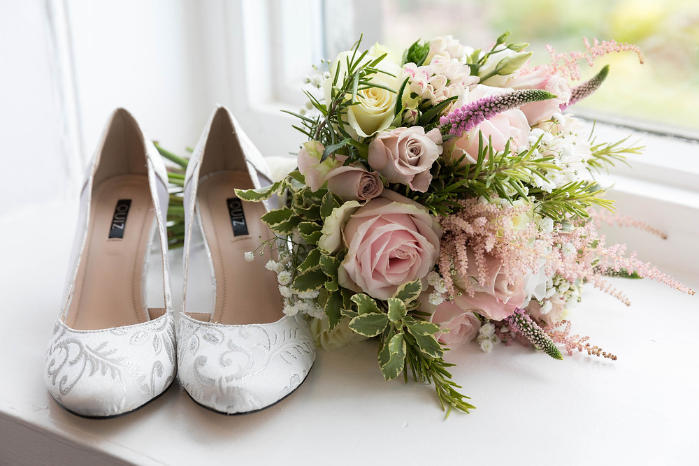 detail shot: The brides shoes & stunning bouquet