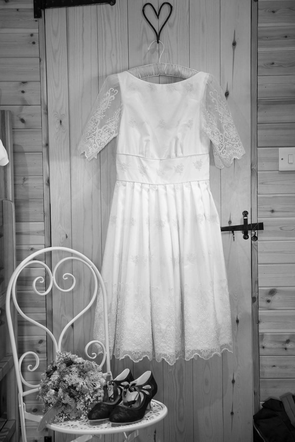 Photograph of hanging wedding dress by Jack Cook Photographer