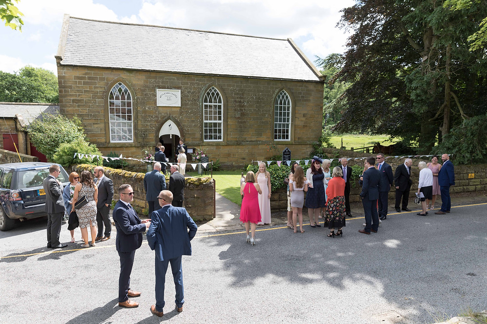 An image of guests at the church by Whitby photographer Jack Cook