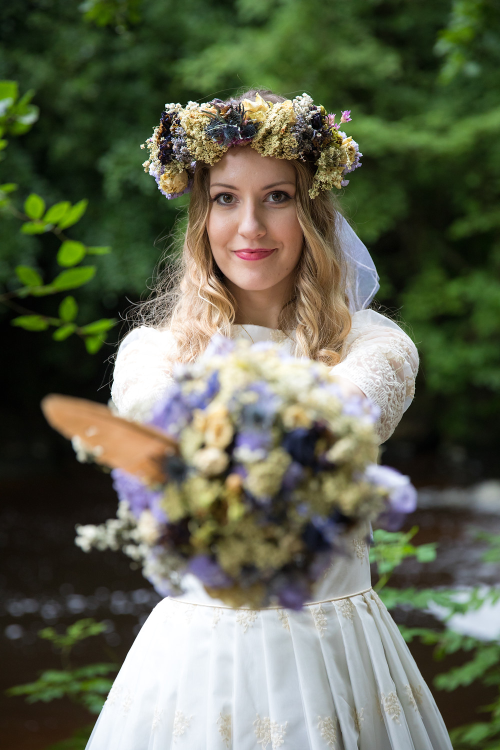 A wedding photo of bride with her bouquet