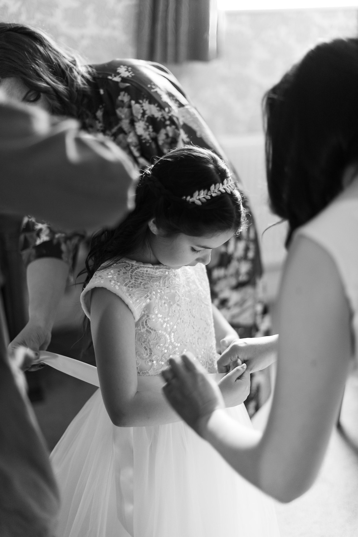 Black & white photo of the flower girl
