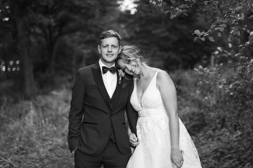 Black and white portrait of the happy couples smiling