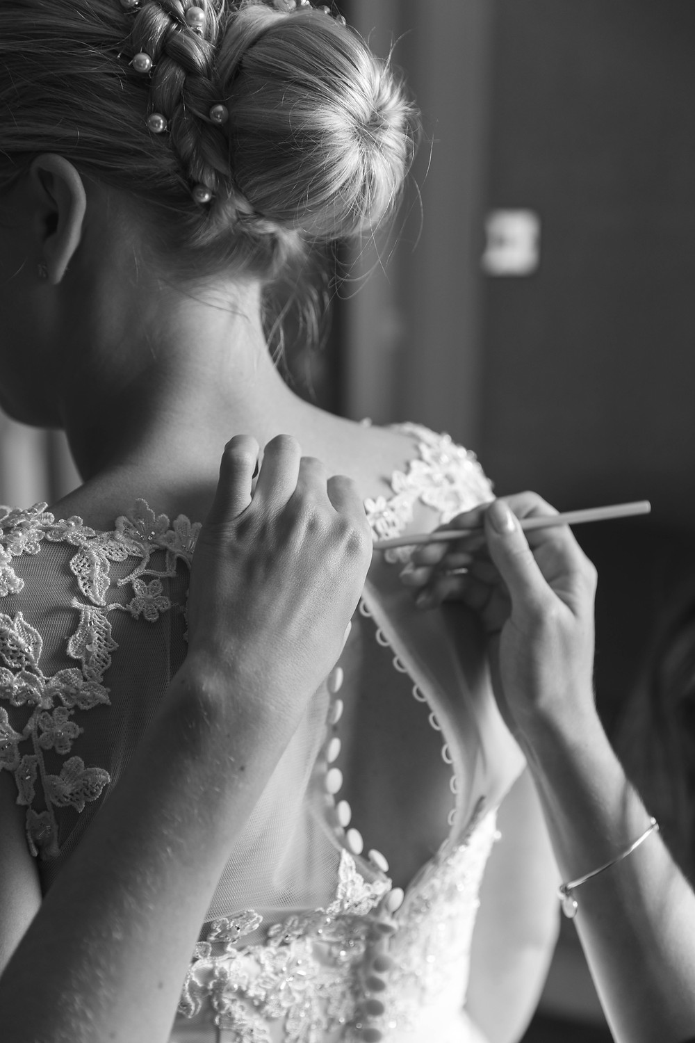 The Bride putting on her wedding dress