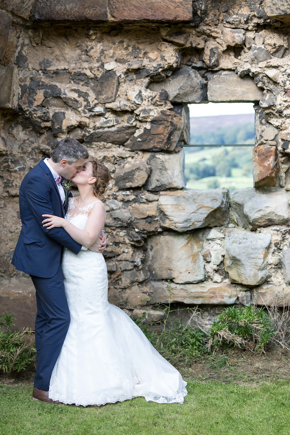 wedding photograph of the bride & Groom in castle ruins