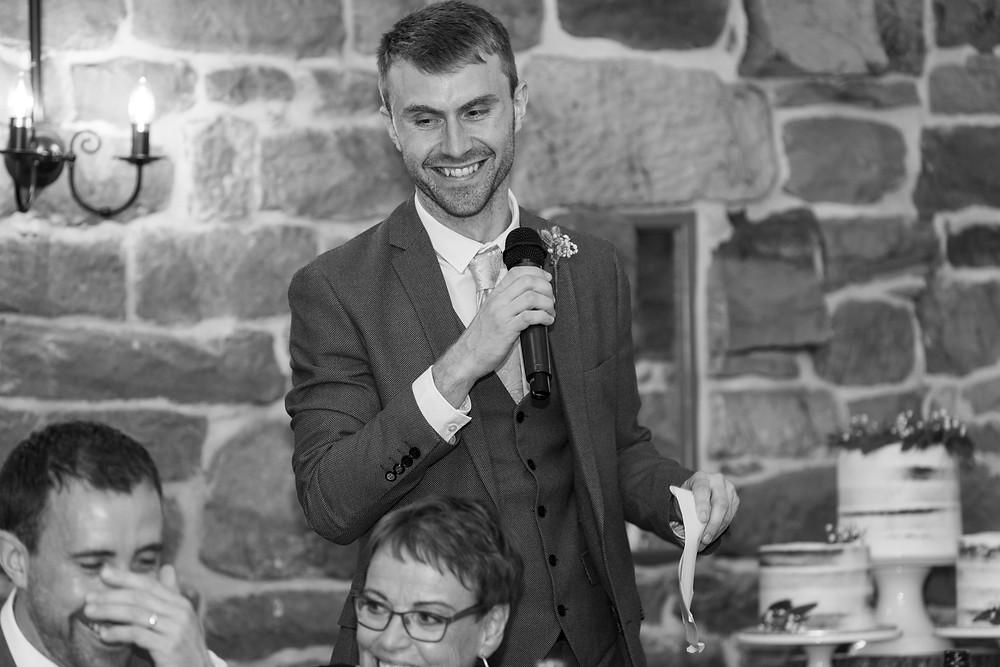 Natural shot of the best man during his speech
