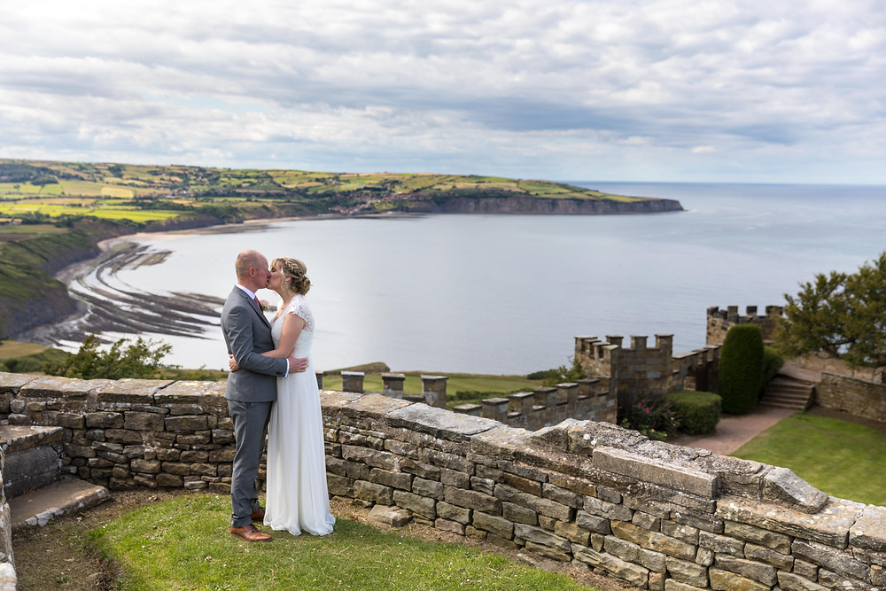 Beautiful wedding photograph of the couple with a coastal background