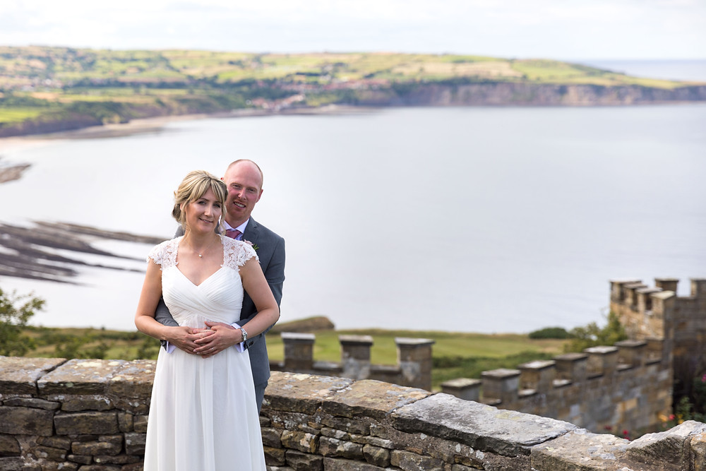 The bride & groom overlooking Robin Hoods Bay, Whitby