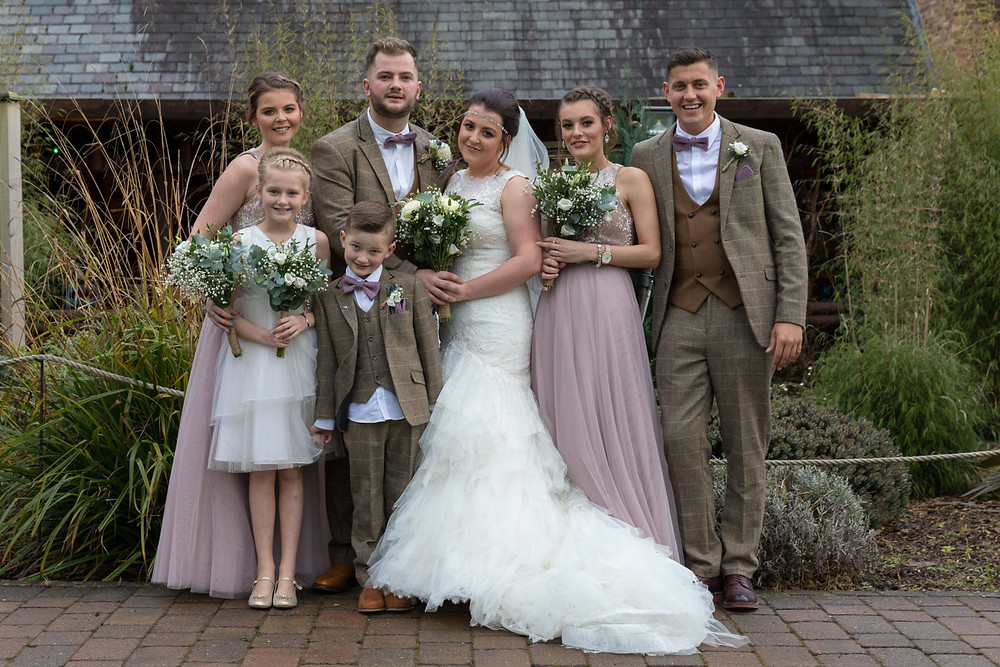 Group photo of the bridal party by Jack Cook