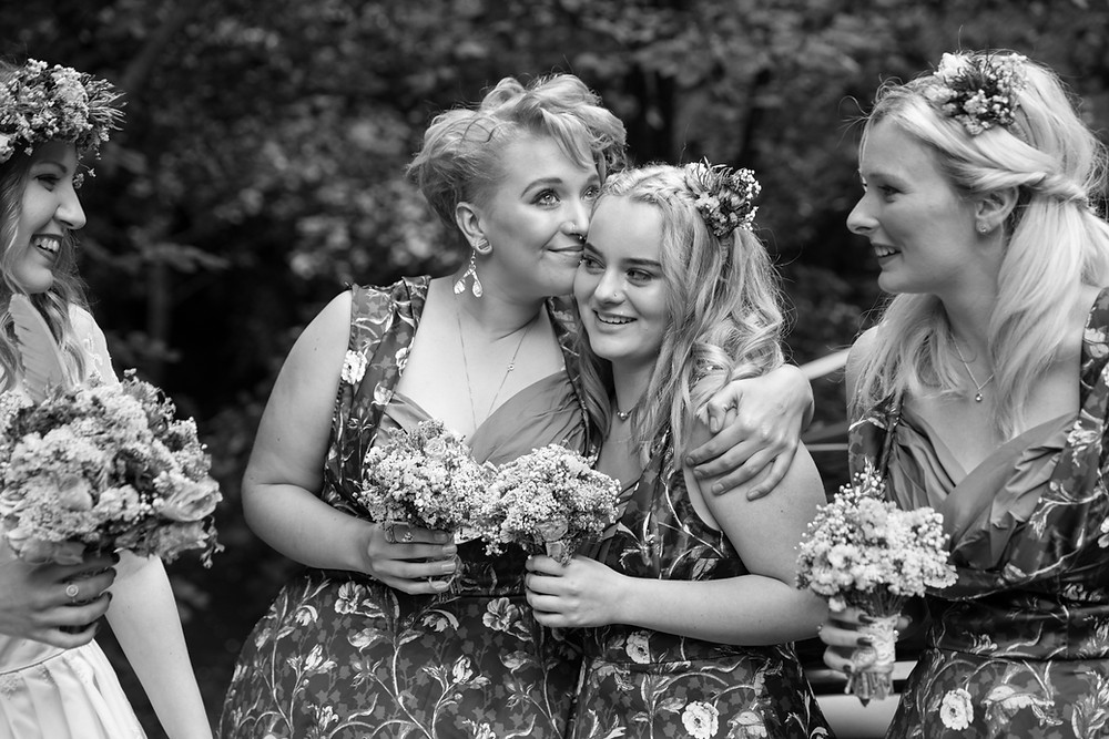 stunning wedding photography of emotional bridesmaids