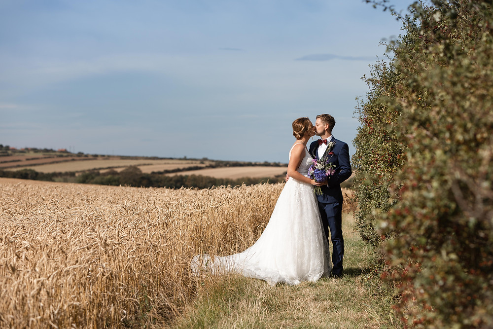 Wedding photography: bride and groom portrait shot in the sunshine