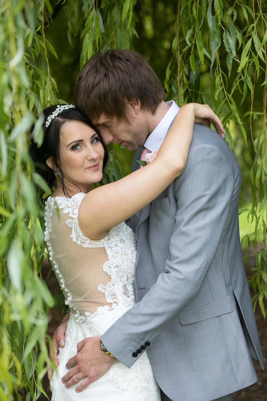 Photo of the bride & groom hugging