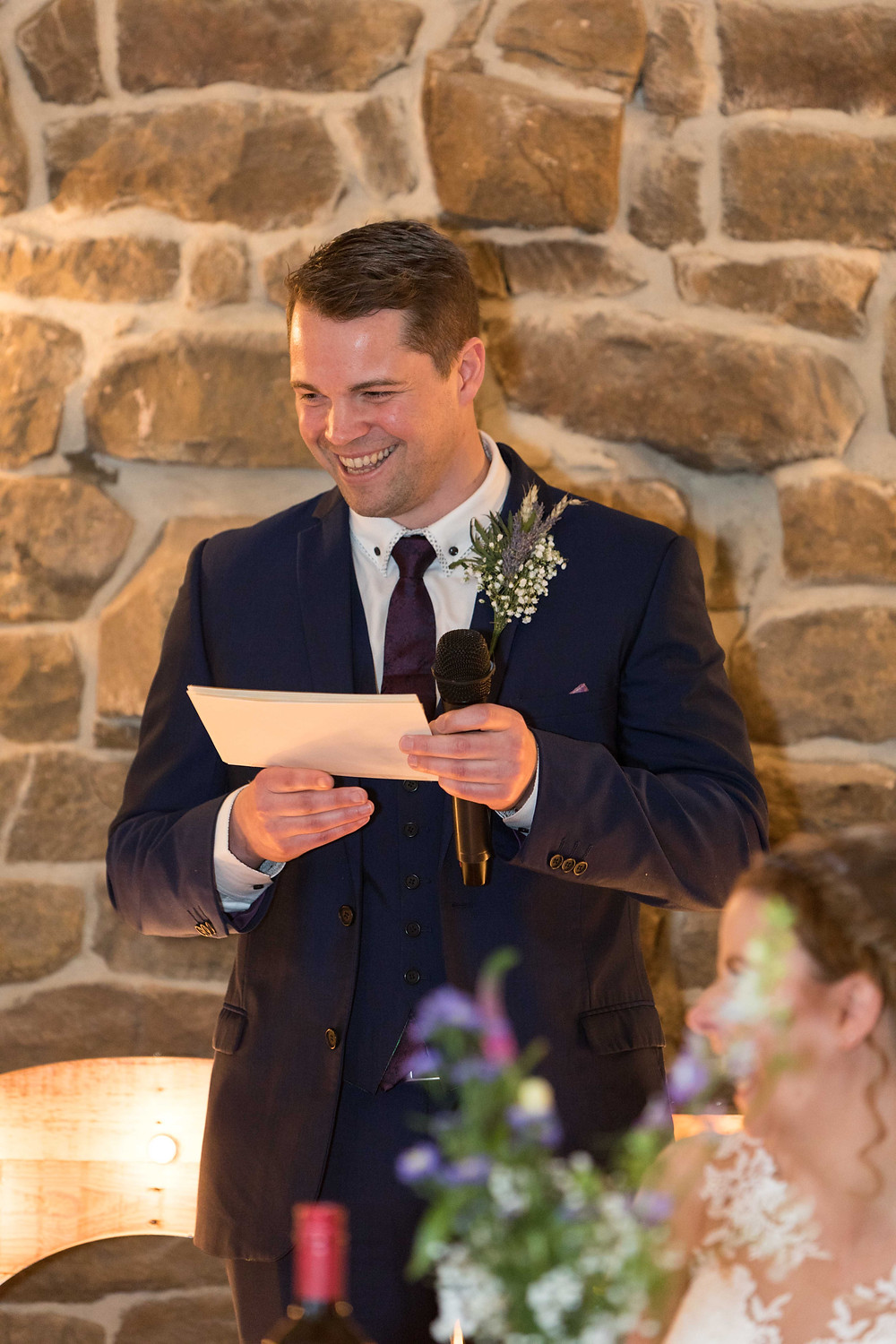 Photo of the best man smiling during his speech