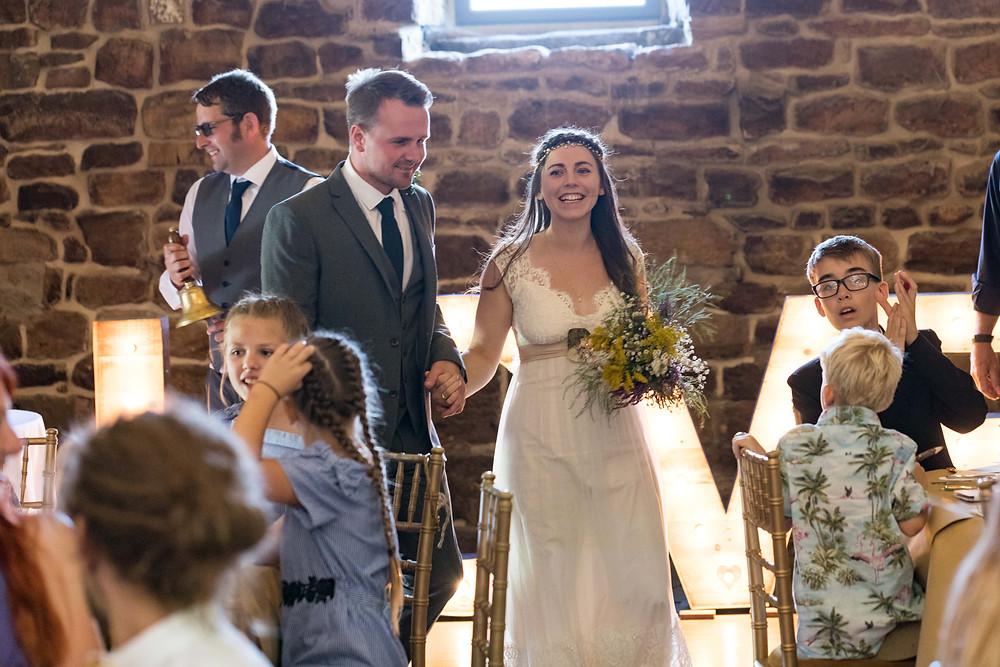 The Bride & Groom entering the reception room