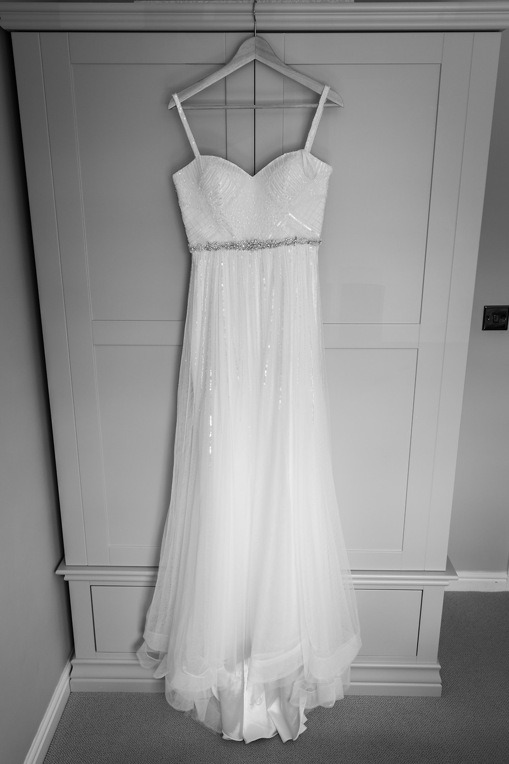 Black and white photo of the bride's dress