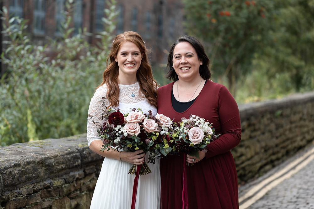 Wedding portrait of the bride and her bridesmaid